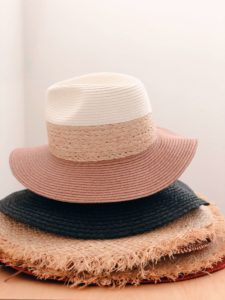 A stack of two hats sit in a stack. Merchandise can be an important part of online fundraising for nonprofits