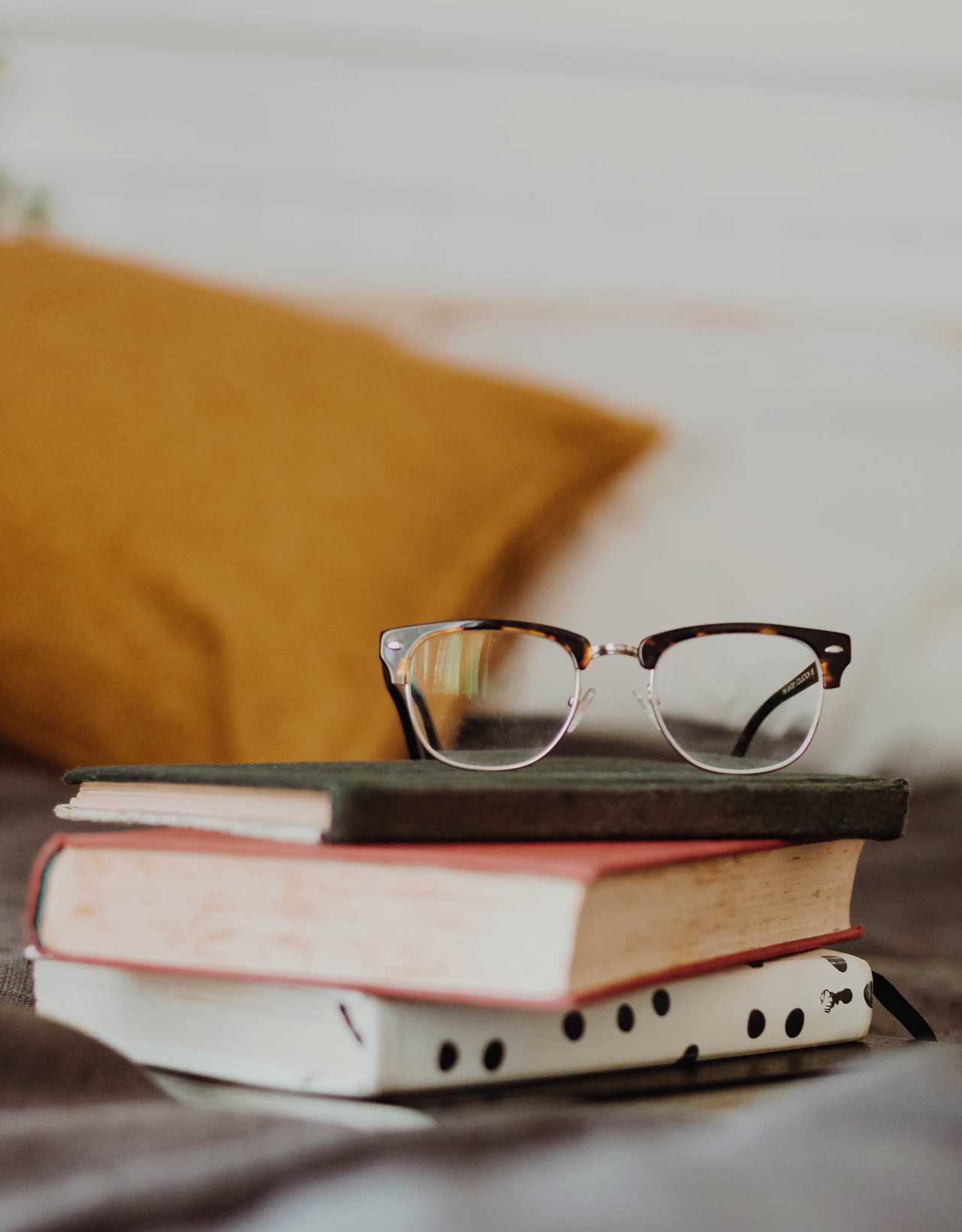 A stack of the best books for nonprofit leaders