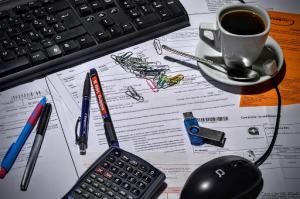 paperwork underneath office supplies